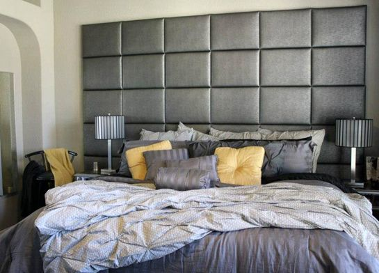 Headboard wall of gray faux leather panels upholstered Wall mounted queen headboard
