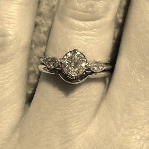 Engagement ring on finger image by Ethical Jewellery Australia