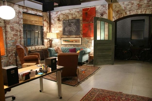 Love the exposed brick walls and area rugs
