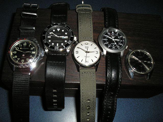 """My watches. From left:  *Vostok Komandirskie on Nato  * Seiko SKX031 on Divestraps leather  * HMT Pilot (white) on Timefactors olive drab Canvas  * Seiko SNK809 """"Flieger"""" on black leather  * Seiko 7005-8027    Total outlay. . . US $415"""