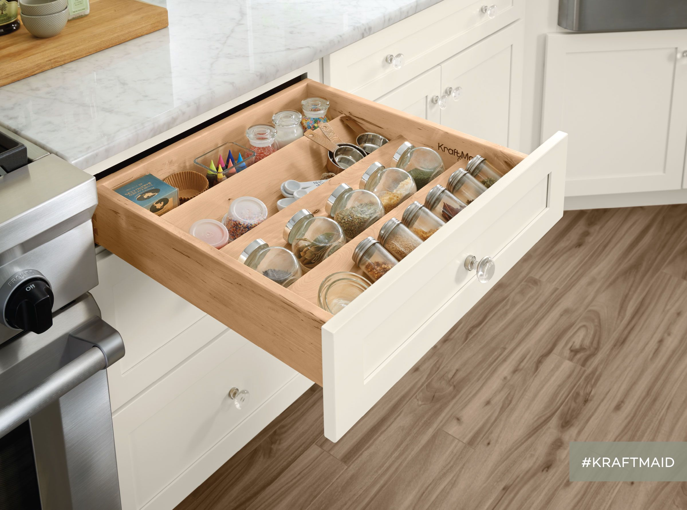 a spice drawer insert in the kitchen encourages cooks to