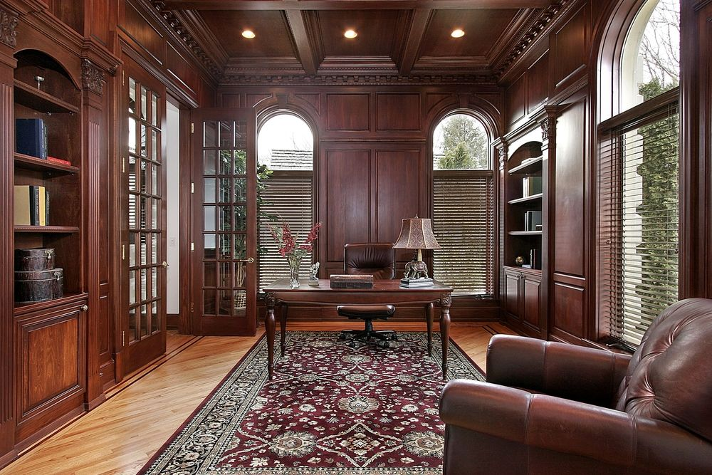 office paneling. luxurious home office with extensive wood paneling ceiling floor rich rug w