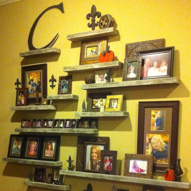 Floating shelves made from an old door. Keep the shelves in varying ...