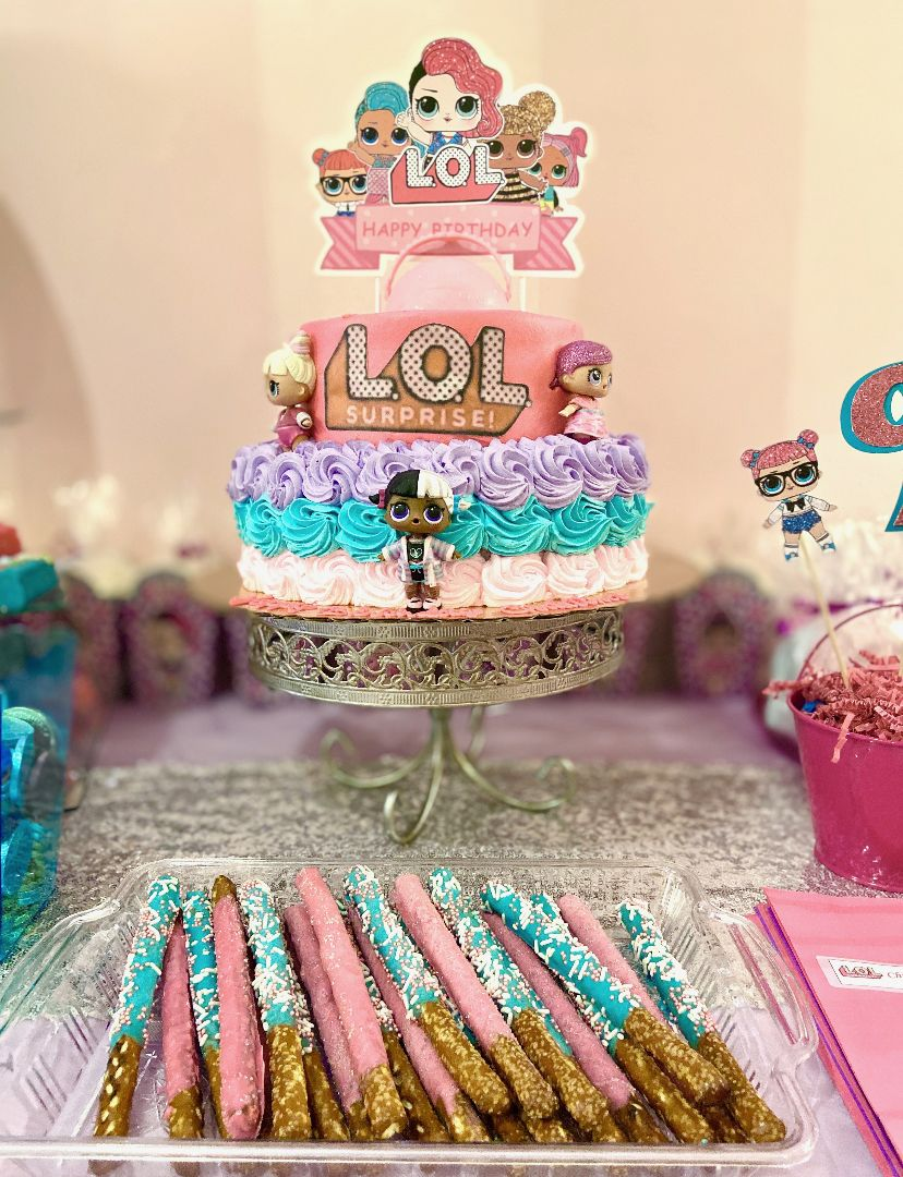 A lol surprise themed cake and dessert table hosted here
