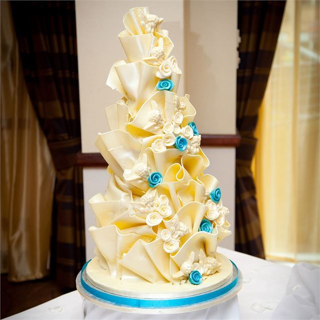 The stunning wedding cake was created by Butterflies and Angels, and ...