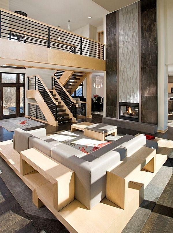 Bold fireplace steel railings define lavish open floor living area ...