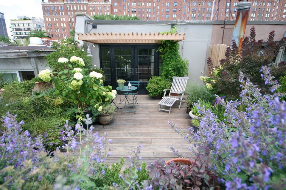 10 Ways to Improve Your Garden with a Pergola is part of Terrace garden Decking - The pergola is understated by nature, an empty frame to accent or support  It doesn't look like much on its own, but a garden without a pergola is like a r