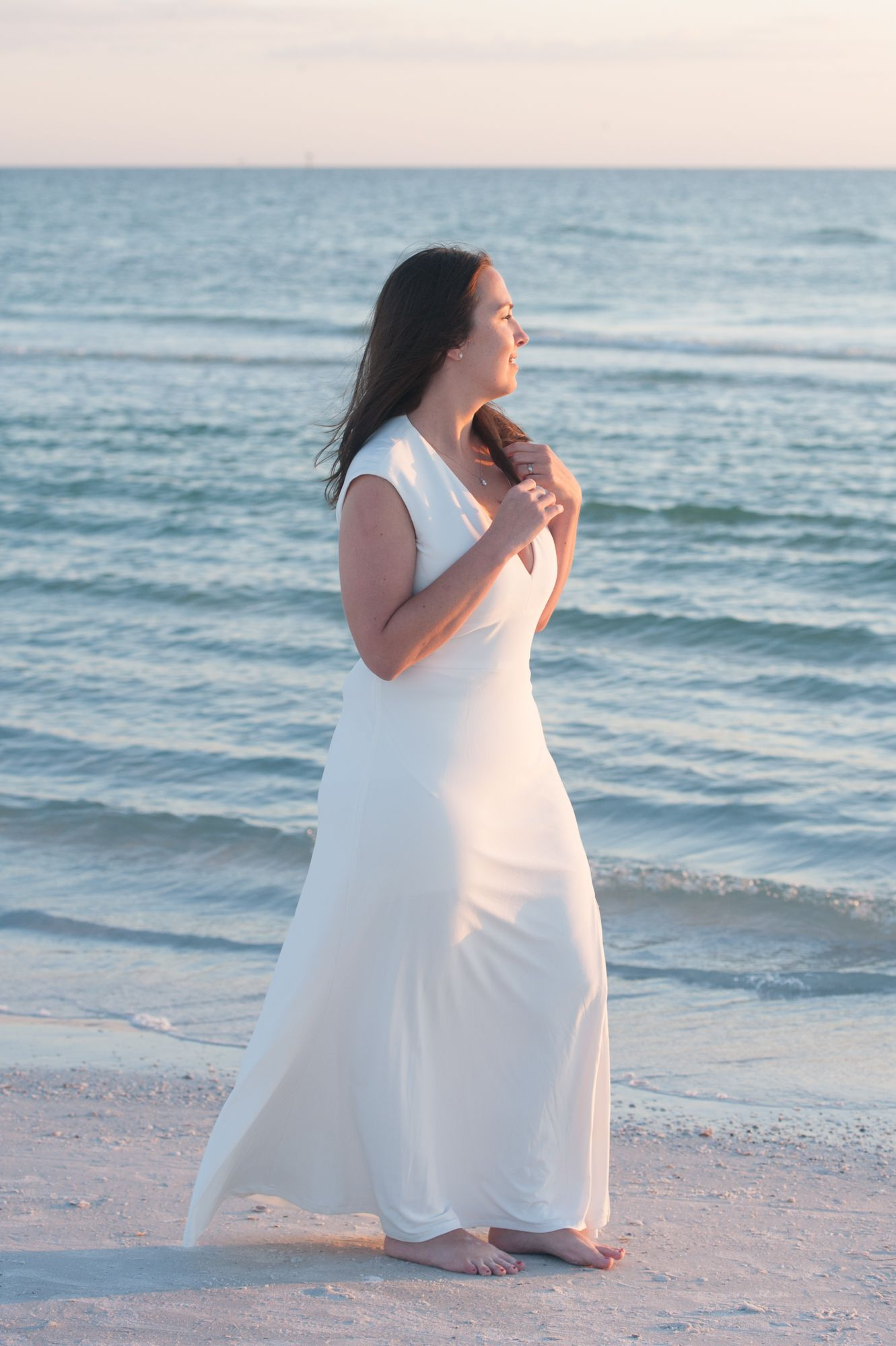 A Cream Colored Beach Wedding Dress That Is Light And Airy In The Florida Breeze