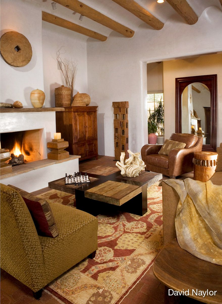 Southwest decor living room  This modern living room features pure shapes Indonesian wood tables