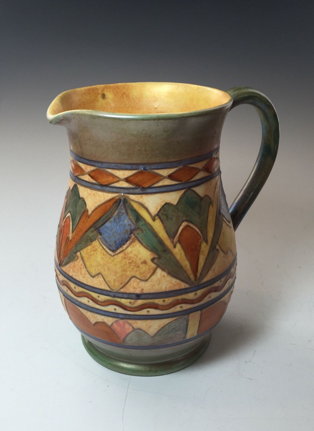 A personal favorite from my Etsy shop https://www.etsy.com/listing/400005013/charlotte-rhead-woods-arabesque-pitcher