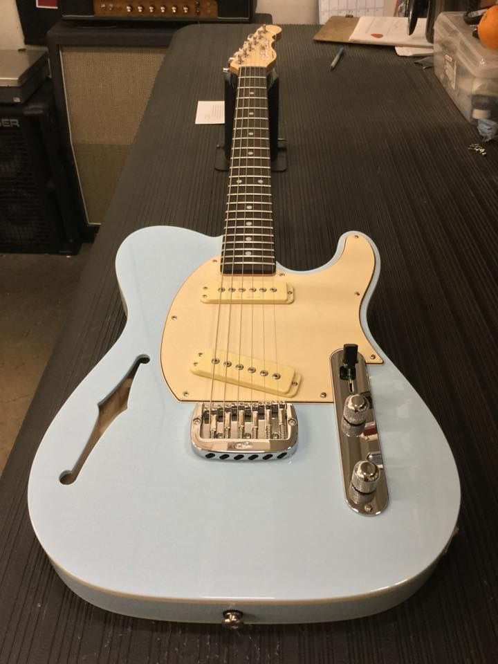 ASAT Special Semi-Hollow in Sonic Blue over swamp ash, double white binding, 3-ply creme guard, Modern Classic profile neck with rosewood board and Clear Satin finish.