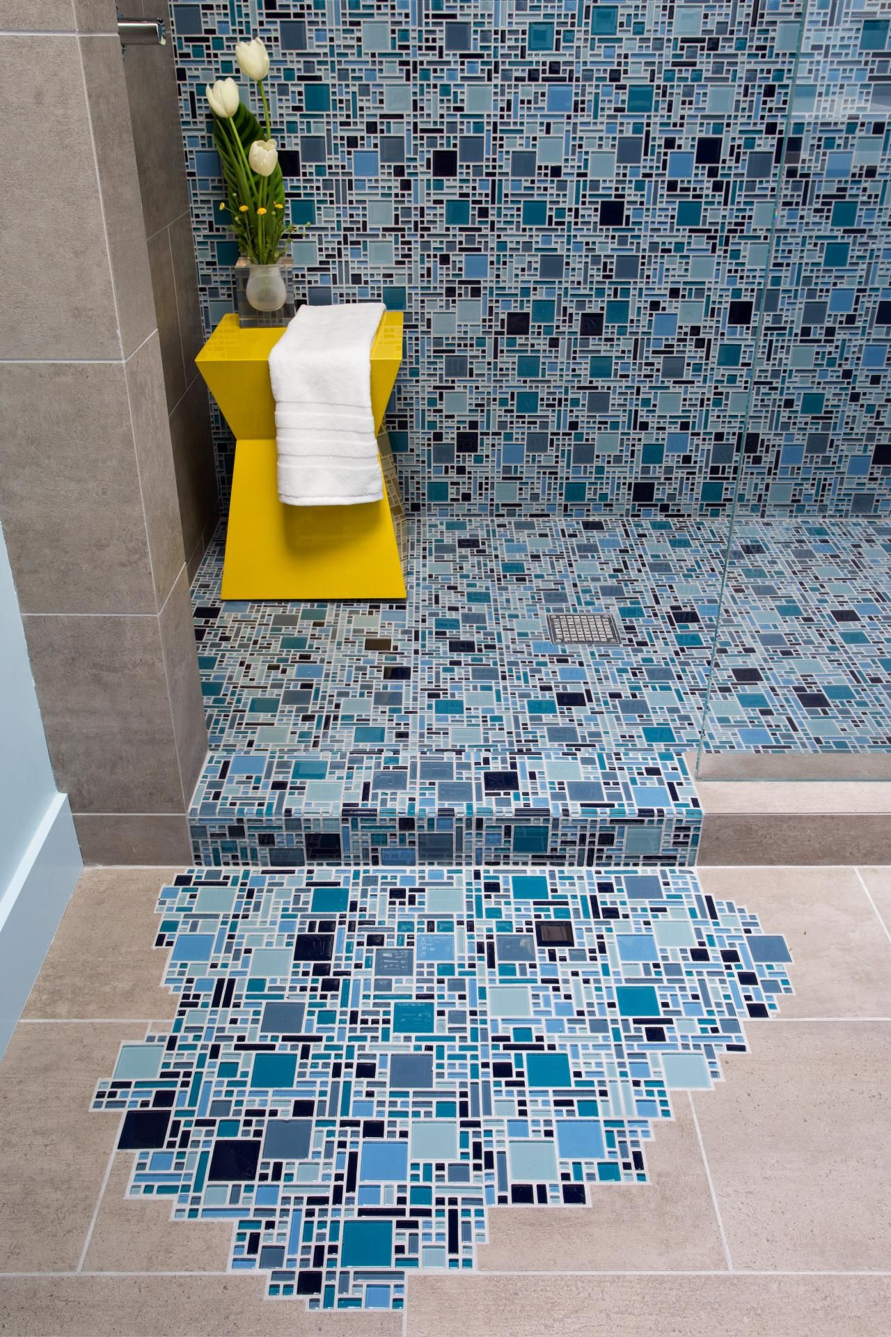 Blue glass mosaic tile with puddling effect on floor hgtv new blue glass mosaic tile with puddling effect on floor hgtv dailygadgetfo Choice Image