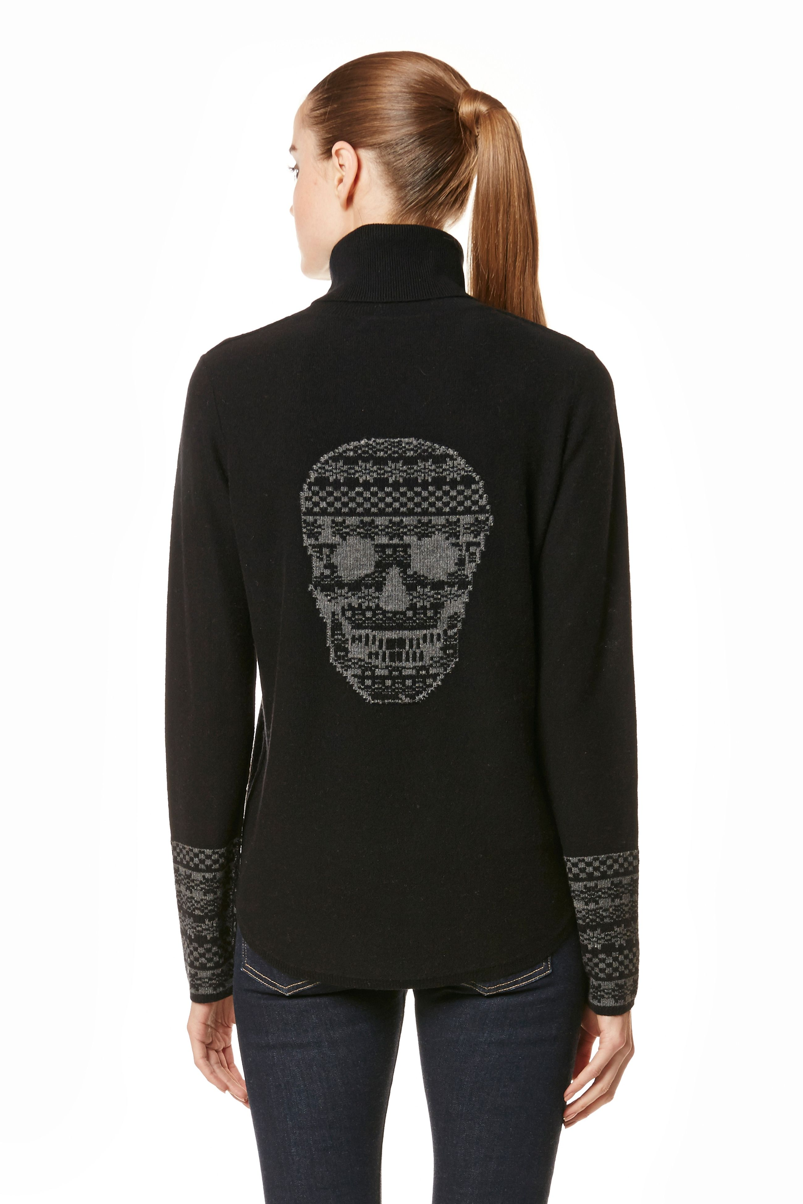 This sleek turtleneck sweater features a Fair Isle-inspired skull ...