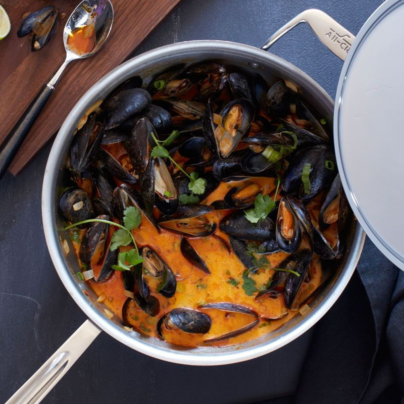 Inexpensive mussels are a boon for busy cooks, as they cook up in a matter of minutes. This recipe takes advantage of prepared red curry paste. Available at almost any grocery store, commercial cur...