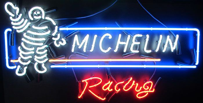 This Michelin Racing Neon Sign Measures 37 Inches Wide And 20 Inches Tall And Features The Michelin Logo Along With The Michelin Tire Man And The Word Racing