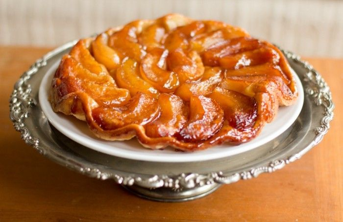 Apple Tarte Tatin.. One of my fav. pastry dishes! Actually the first pie/tart with apple I ever made at about 12! I slice my apples thin and pile them high very carefully and somewhat organized! They compress down during the baking process and the carmelization is awesome! This is a really easy elegant option to a traditional apple pie! Less carbs too with no top crust!