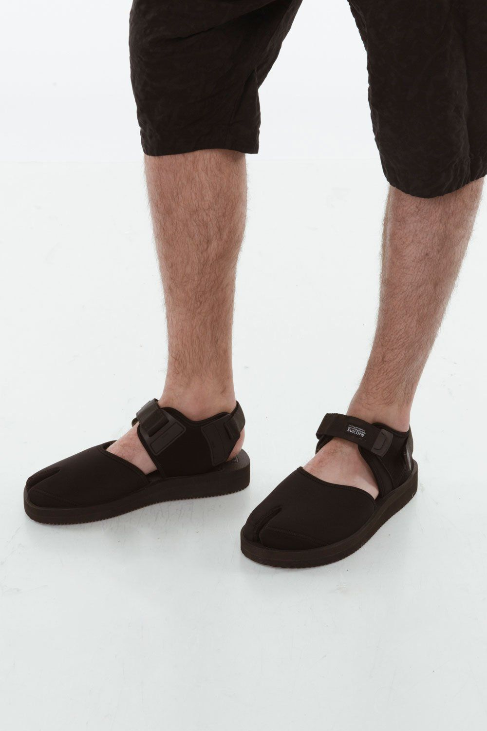 d936fedd35c8 SUICOKE BITA-V  215.00 DESCRIPTION BITA-V in black by Suicoke. Round tabi  sandal with adjustable webbing velcro straps. Tonal rubber footbed and  treaded ...