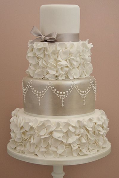 I like the layers with the petals, and the silver too! Vintage cake from #conttonandcrumbs #BridalGuideMagazine