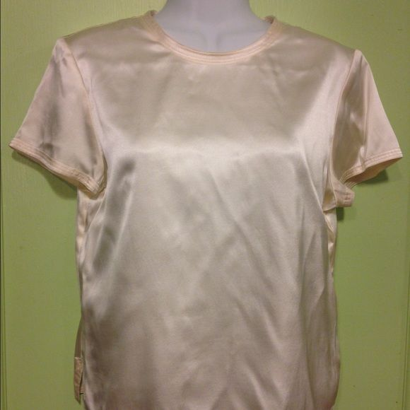 "JOSEPHINE CHAUS - Ivory Silky Top Josephine Chaus Top Size: 4 Descriptions: Ivory silky top. Cap sleeve. Crew neck. Slit on each side of bottom hem. One button closer along back neckline w/ Keyhole. 93% silk/7% spandex. Condition: Excellent used condition. Slightly wrinkled from storage. Dimensions: 13"" from armpit to bottom hem. 19.5"" from armpit to armpit. .5"" from armpit to sleeve hem. Inventory Reference: #T425 Josephine Chaus Tops Blouses"