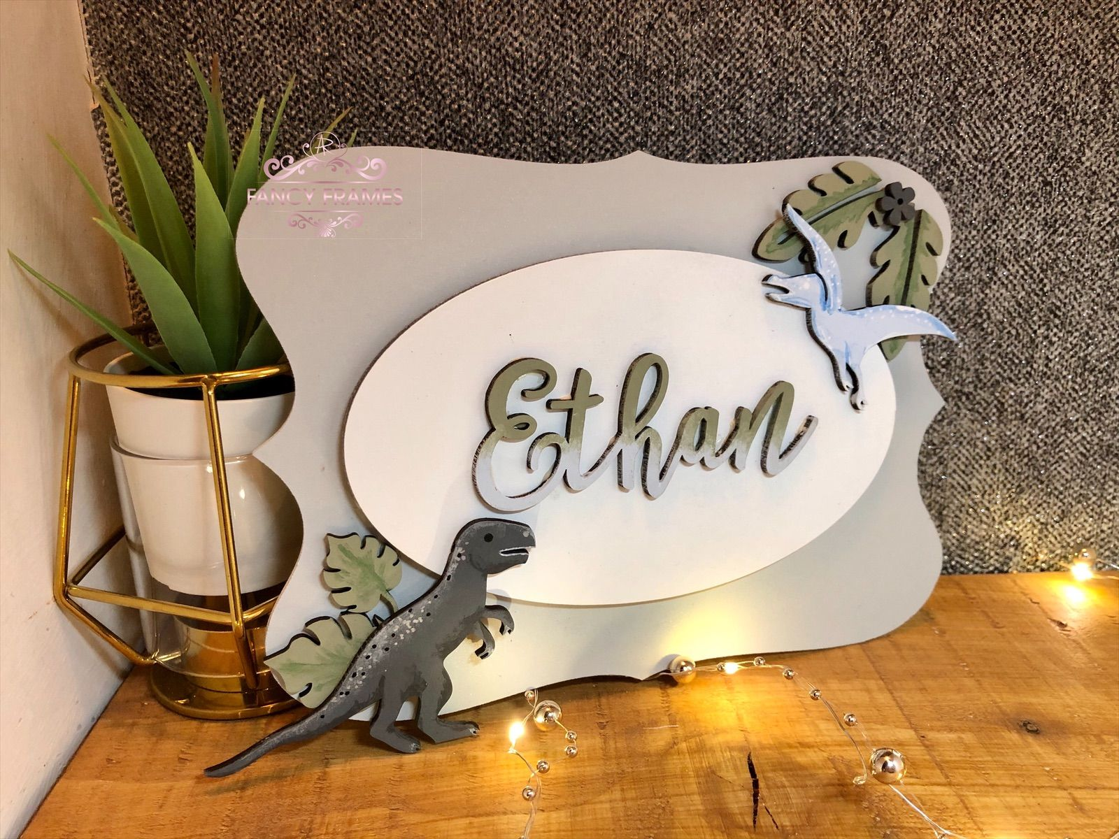 Personalised dinosaur plaque in neutral greys, earthy greens and baby blues    #streetsign #trexdoorsign #nurserywallplaque #handpaintedsign #boysbedroom #hangingplaque #dinosaurname #dinosaurdoorsign #boysnurserydecor #woodenhangingsign #dinosaurwallart #dinosaurtheme #personalisedname  #dinosaur  #dinosaurnursery