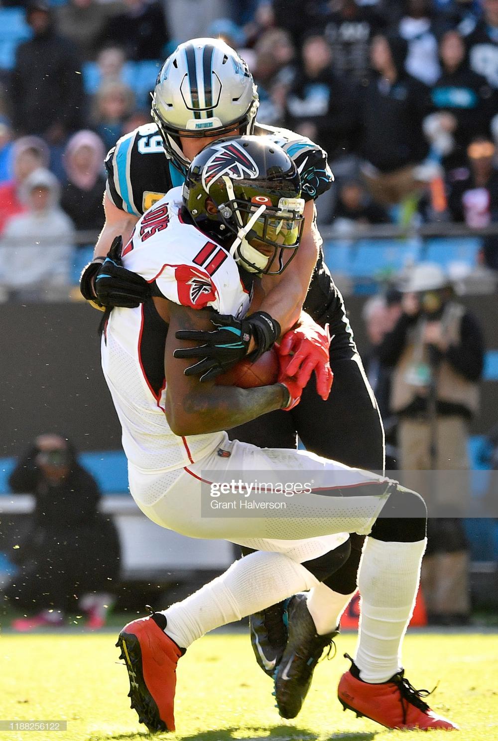 Julio Jones Of The Atlanta Falcons Makes A Catch Against Luke Kuechly Atlanta Falcons Luke Kuechly Julio Jones