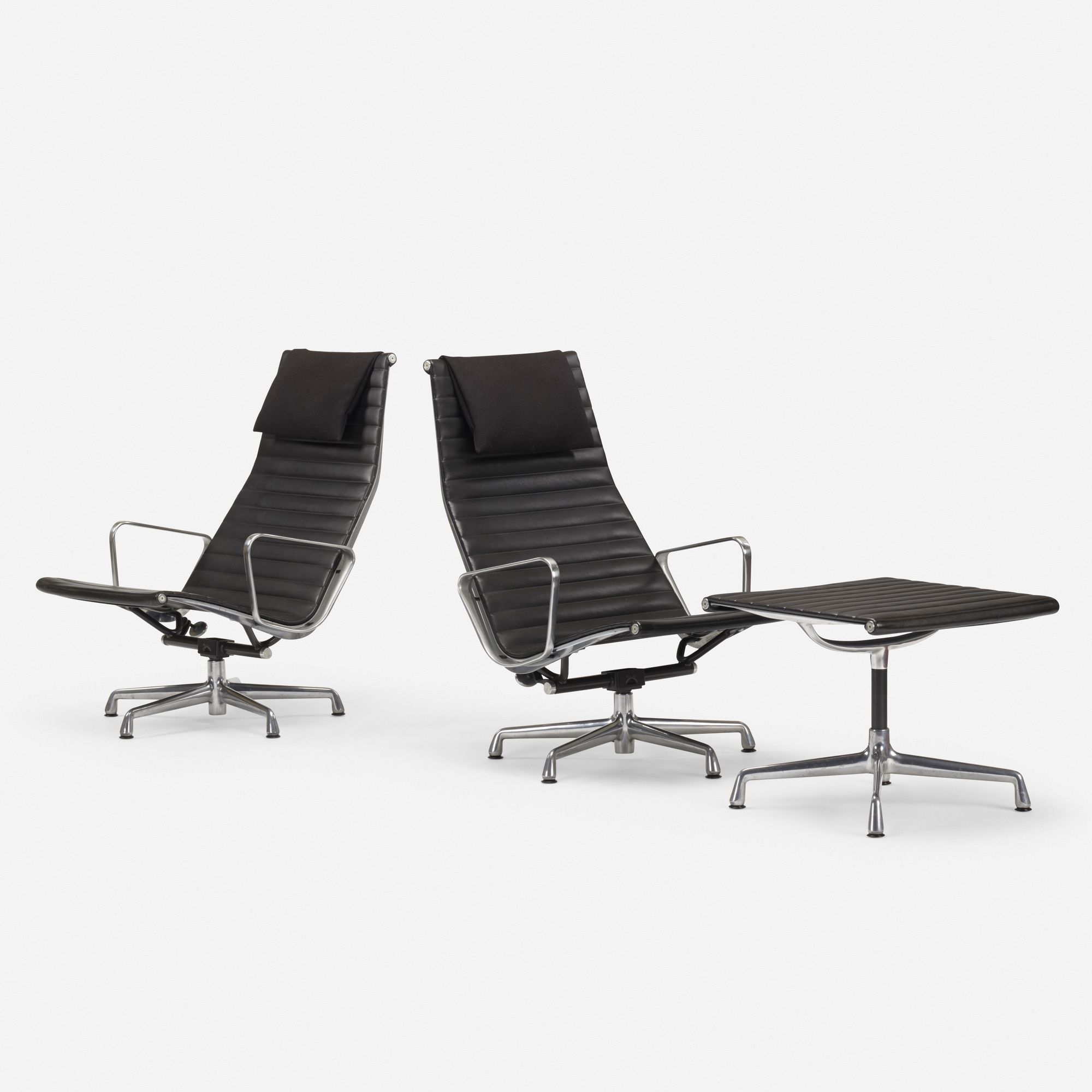 Charles and ray eames aluminum group lounge chairs pair