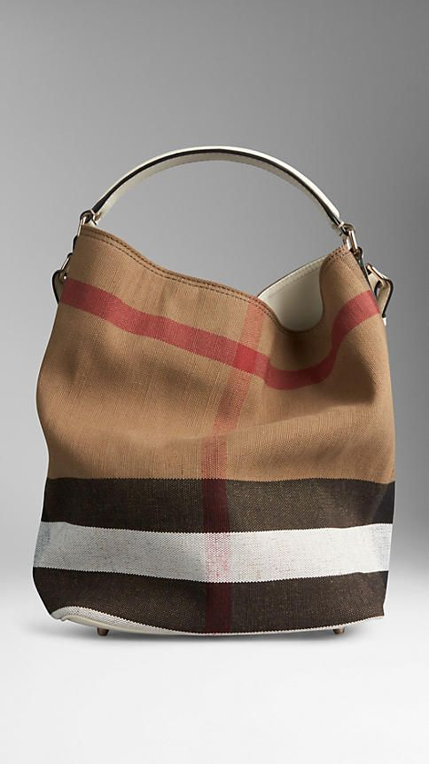 3eafc39d83 White Medium Canvas Check Hobo Bag from Burberry - Jute cotton hobo bag in Canvas  check with a leather base. Open top with metal clip fastening.