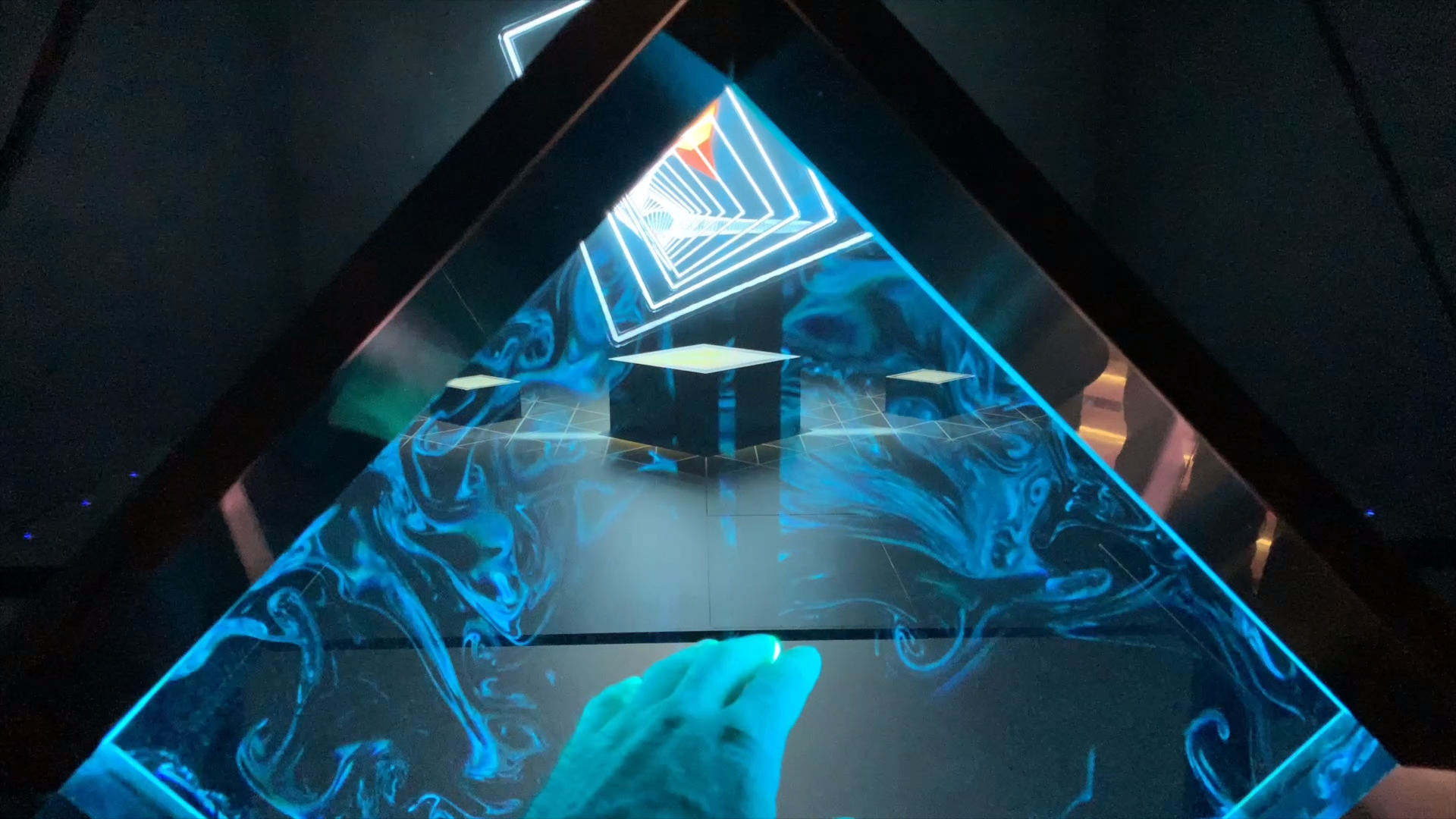 A diamond-shaped portal standing in front of a holographic theater allows people to browse contents by natural hand's movements. By pointing with fingers, the users can browse different contents #holo #hologram #interaction #interactive #installation #gestures #design #exhibition #mesmerizing #dmx #effects - Pavillion Design, Content Experience and Construction: Simmetrico S.r.l. General Contractor and Surveyor: Illogic S.r.l.