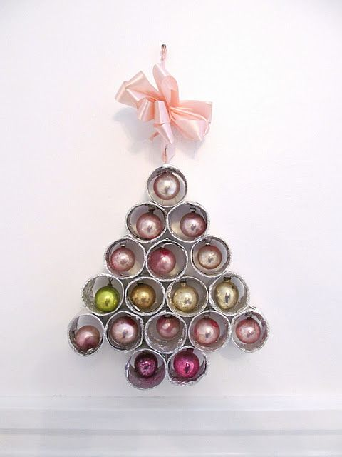 made from paper towel rolls, aluminum foil and vintage ornaments