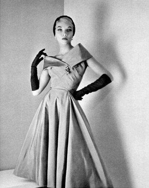 Model in silk faille cocktail dress by Jean Desses in a photo by Philippe Pottier, 1955