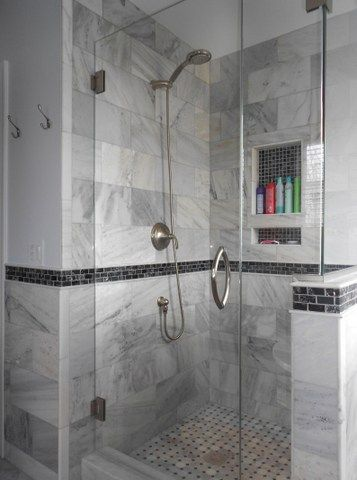 The Frameless Glass Shower Is Accented by Providence Carrara Marble Tile And Black Magic Shimmer Glass Tile