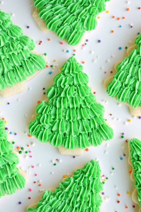 Sugar cookies are livened with bright green frosting to create Christmas trees made for eating. Get the recipe at One Little Project.