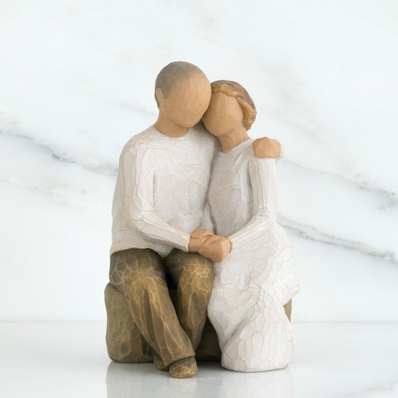 """A wedding, anniversary or Valentine's Day gift that expresses love and caring. Works well in Family Groupings. Willow Tree is a reminder of someone we want to keep close, or a memory we want to touch. Hand-carved figures reveal their expression through body gestures only… a tilt of the head, placement of the hands, a turn of the body. Each piece is designed to be open to interpretation from the viewer. """"Willow Tree isn't so much about the tangible piece. It represents an emotion, or it marks a m"""