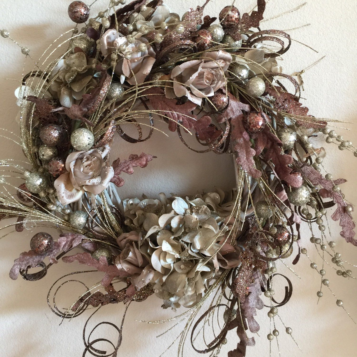 Small willow wreath with an amazing Array of colors in shades of silver,  pale gold