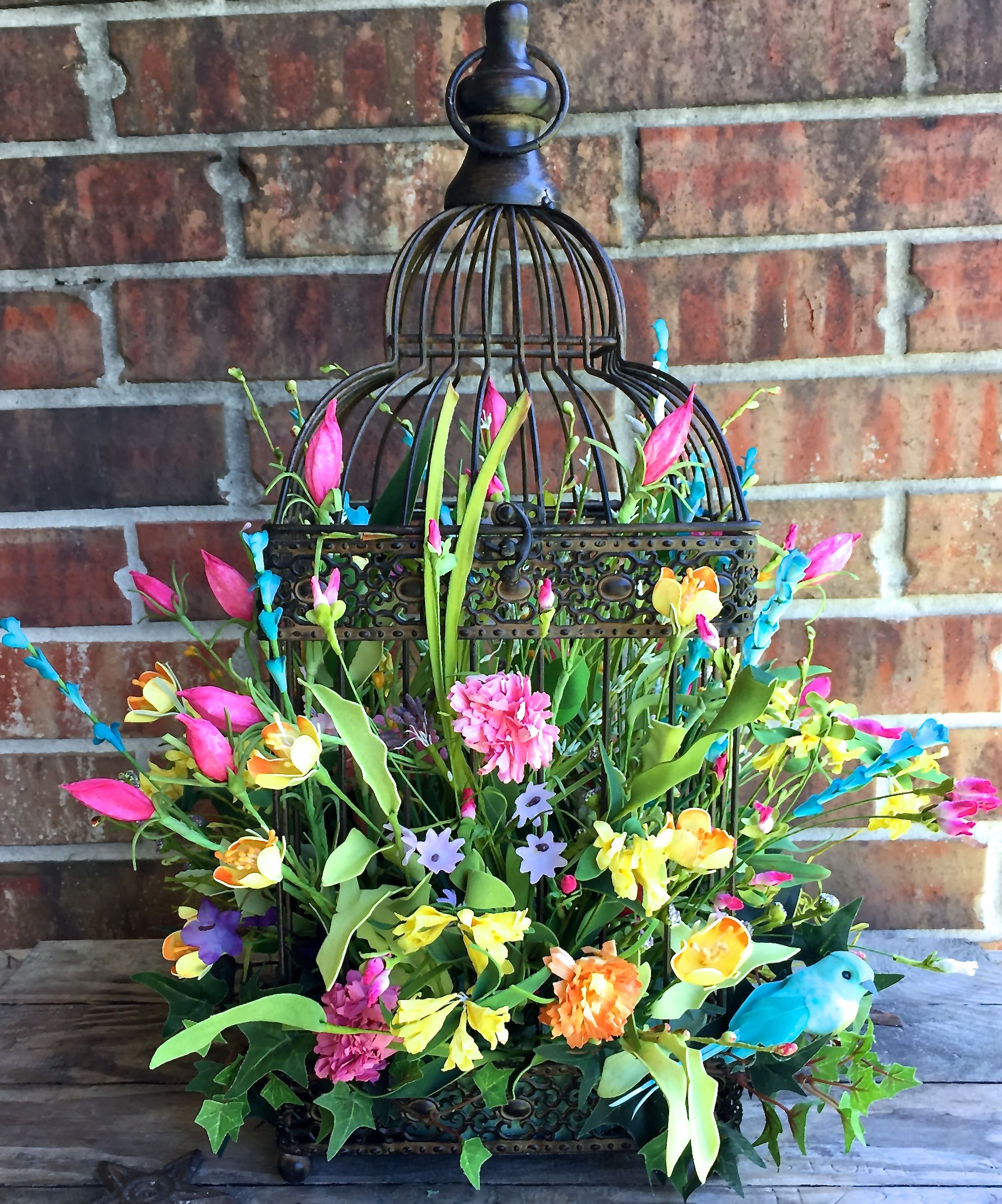 Beautiful summer/spring floral arrangement in a birdcage visit www.facebook.com/southernsass