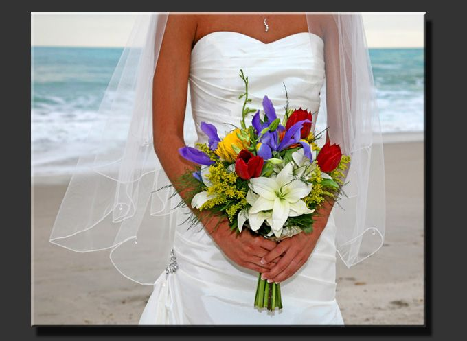 this is beautiful boquet for the bride. the colors are red, purple, yellowe, and white