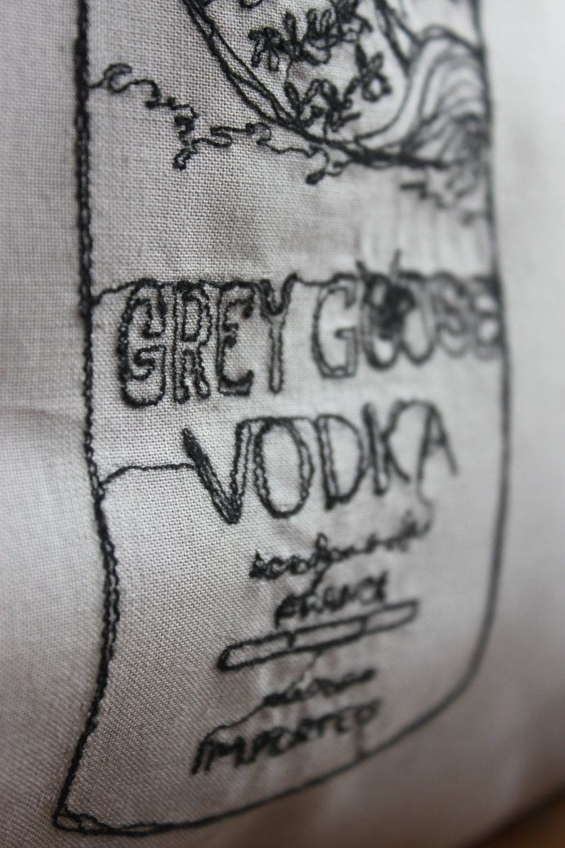 Grey Goose Vodka Bottle Embroidered Cushion Cover - Dove Grey. £28.00, via Etsy.