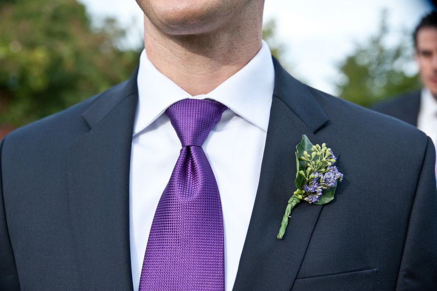 Groom And Groomsmen In Black Suits White Shirts And Purple Ties