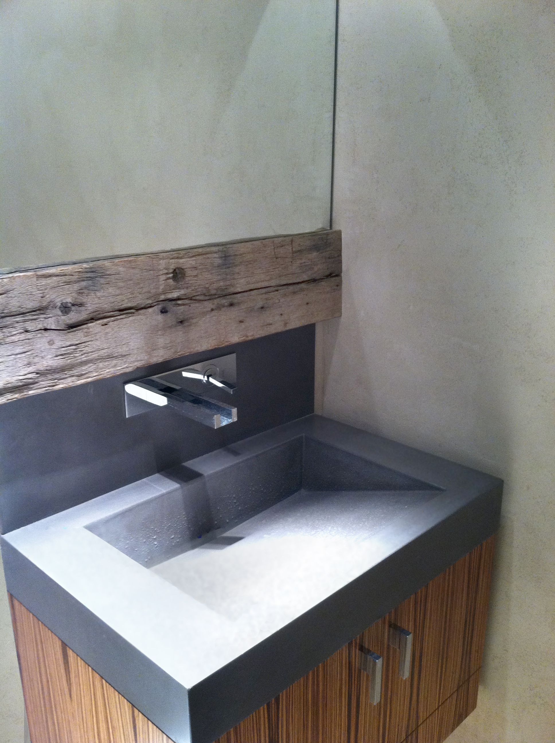 This concrete sink was placed into a transitional apartment in