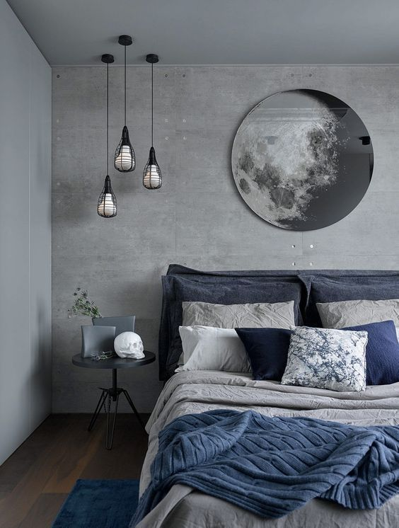 Photo of Chic gray and dark blue bedding and a blue carpet enliven the decoration