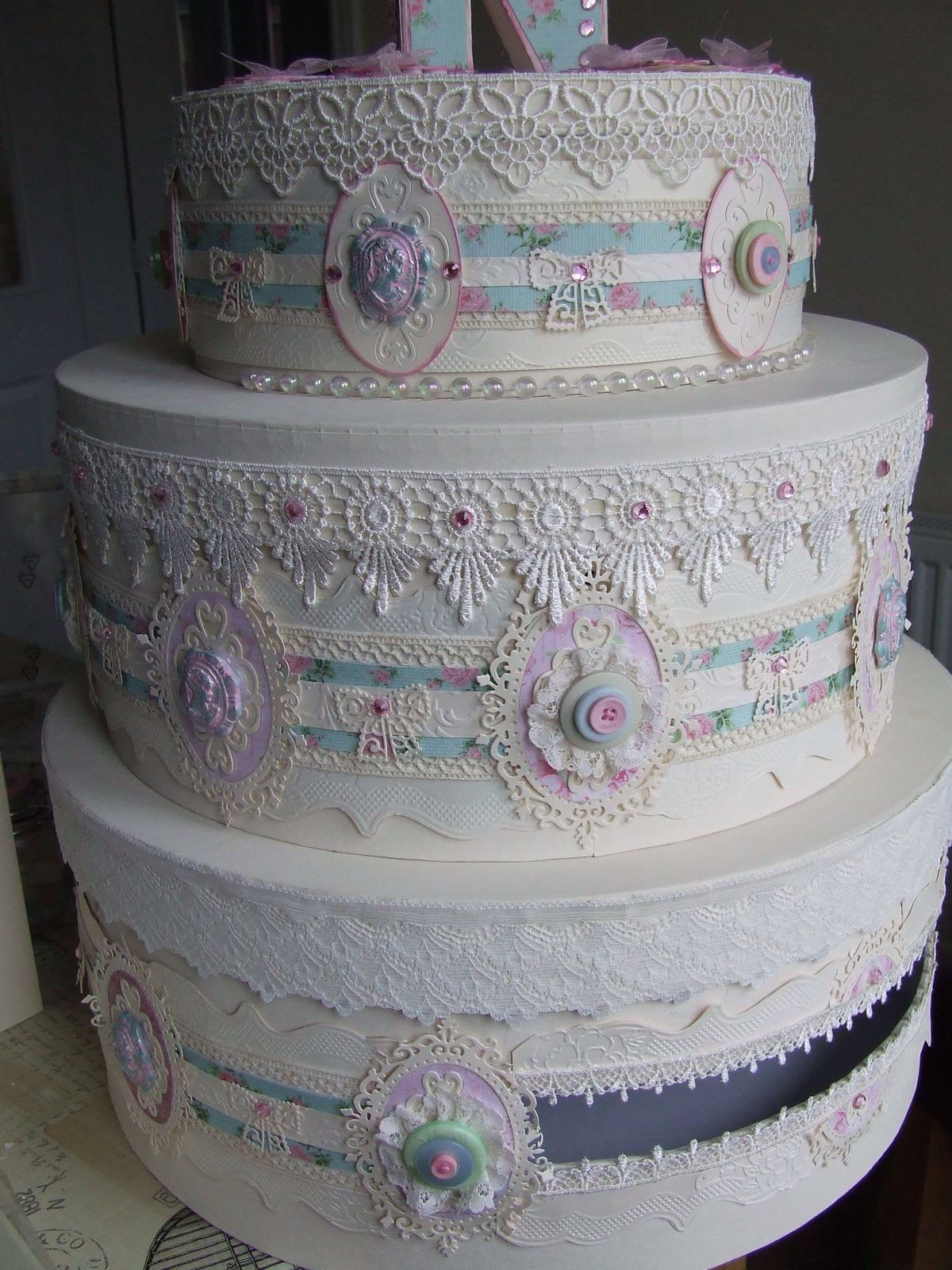 Tattered Lace s used to decorate a wedding cake box