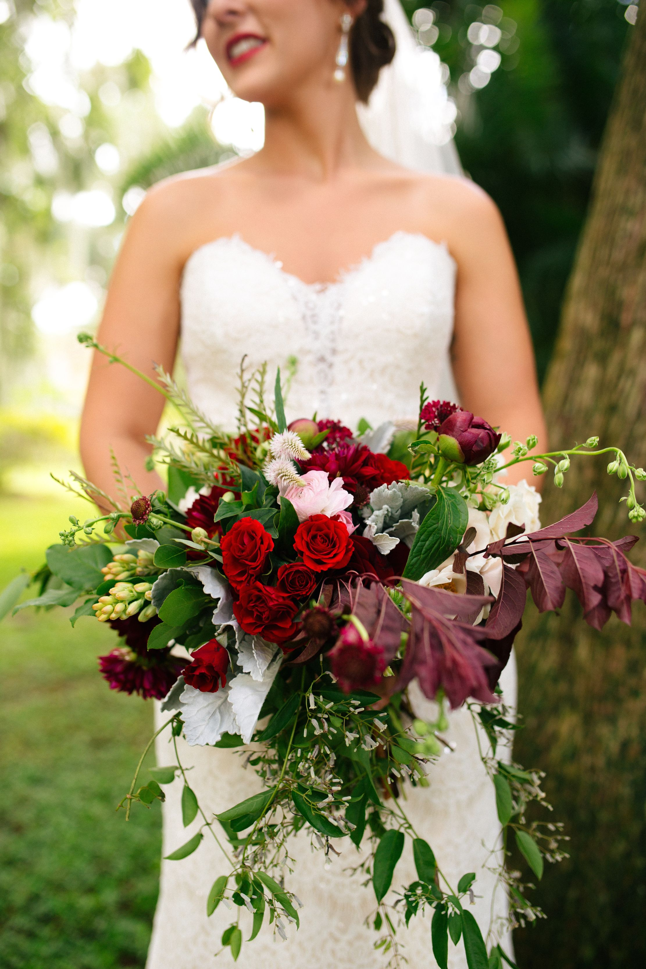 loose and wild organic bridal bouquet of burgundy dahlia