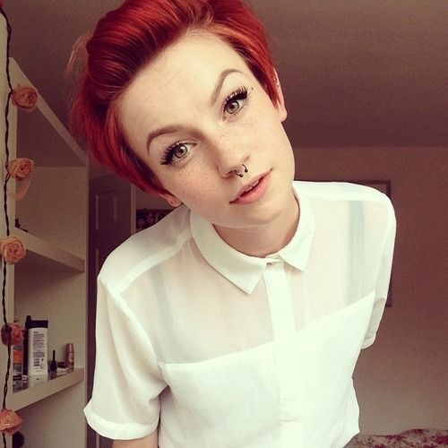 Perfect. Bright red hair, pixie cute, piercings, and her makeup.