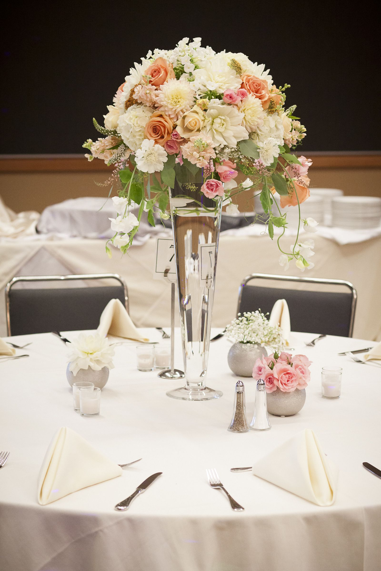 wedding centerpiece with blush and peach roses, white hydrangea and ...