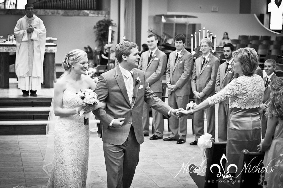 documentary wedding pictures at St Frances Cabrini church, Denver wedding photographer