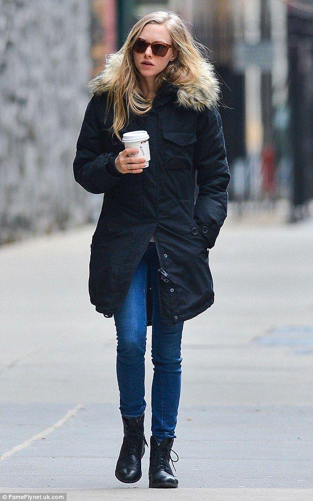 Coffee fix: Amanda enjoys a hot beverage as she walks through New York...