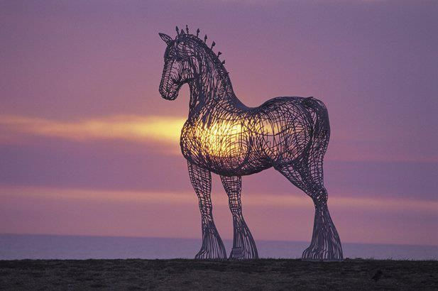 Heavy Horse by Andy Scott overlooking the M8 at Glasgow Business Park, Easterhouse.  This sculpture of a Clydesdale has become one of the best known artworks in Scotland. Sited beside the M8 motorway between Glasgow and Edinburgh, it stands 4.5 metres tall at the head and is made of galvanised steel round bars.