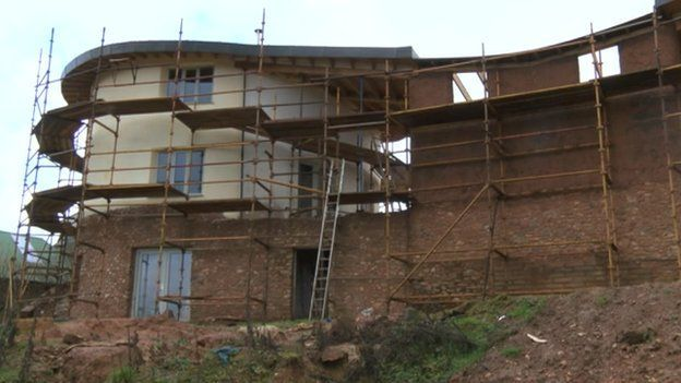 the man building a house out of mud | devon, traditional and house
