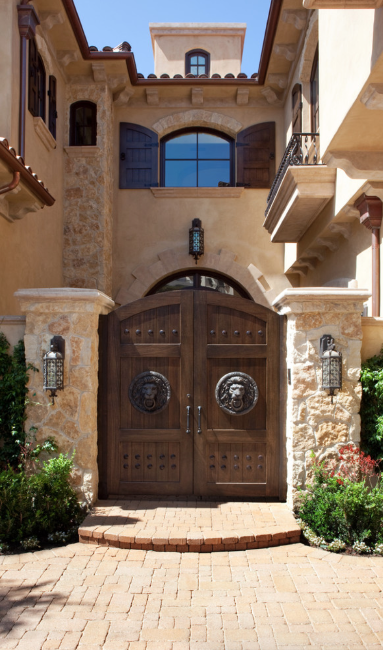Love the lions on this entry gate tuscany homes w stones