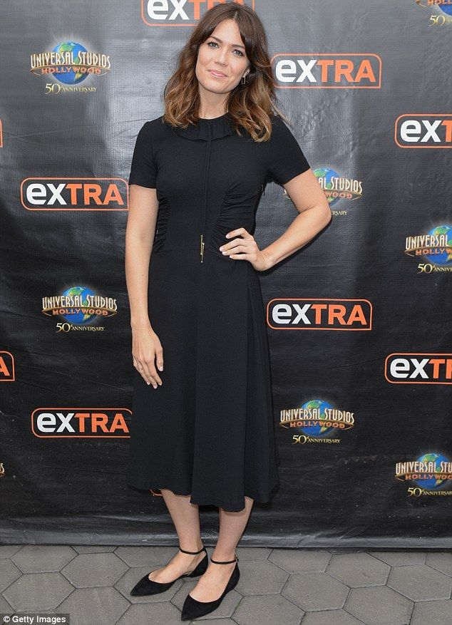 Little black delight: Mandy Moore looked fabulous as she visited Extra in LA on Tuesday...